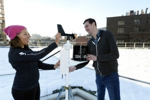 The Weather Company Meteorologist, Jess Parker (left) works with IBM Watson Developer Chris Ackerson (right) to install a personal weather station on the roof of IBM Watson Headquarters at Astor Place in New York City. IBM today announced that it has closed the acquisition of The Weather Company's B2B, mobile and cloud-based web-properties, weather.com, Weather Underground, The Weather Company brand and WSI, its global business-to-business brand. (Jon Simon/Feature Photo Service for IBM)